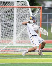 Hartland goalie Bryce Avenall makes a save in a 17-11 victory over Midland in a regional championship lacrosse game at Linden on Tuesday, May 28, 2019.
