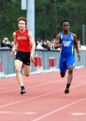 Pinckney's Dylan Reason (left) took first in the 200 meters and second in the 100 at the Larry Steeb Memorial Meet of Champions.