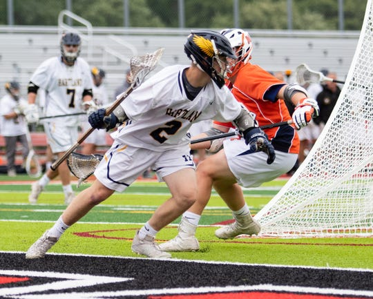 Hartland freshman Bo Lockwood had four goals and four assists in a 17-11 victory over Midland in a regional championship lacrosse game at Linden on Tuesday, May 28, 2019.