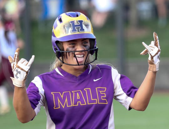 Male's Madison McCoy celebrates after getting on base in the Seventh Region Championship against Assumption on May 28, 2019.