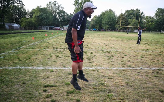 Derby City head coach Thomas Jackson is animated on the sideline, as well as on the field during game action.  Jackson is a former Marine and junior college football player in California, and in his second year as head coach of the Dynamite.