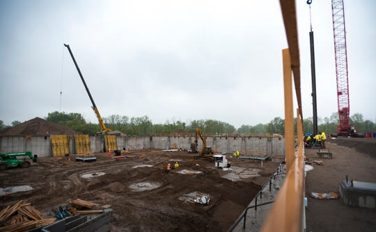 Iron workers set the first steel beam at the future site of McLaren Greater Lansing Wednesday morning, May 29, 2019, in University Corporate Research Park, between Collins Road and US 127. More than 3,200 tons of structural steel is being used to build the new hospital.
