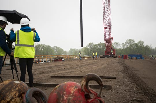 Iron workers prepare to set the first steel beam at the future site of McLaren Greater Lansing Wednesday morning, May 29, 2019, at University Corporate Research Park, between Collins Road and US 127. More than 3,200 tons of structural steel is being used to build the new hospital.