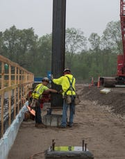 Iron workers prepare to set the first steel beam at the site of McLaren Greater Lansing's new 240-bed hospital Wednesday morning, May 29, 2019, at University Corporate Research Park between Collins Road and US 127. More than 3,200 tons of structural steel is being used to build the new hospital.