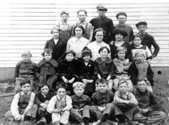 Students at Merle Beach School, where local students were taught for more than 90 years before it closed in 1966.