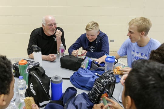Roncalli High School Principal Tim Olson chats with freshmen students during their lunch at Roncalli High School May 17 in Manitowoc.