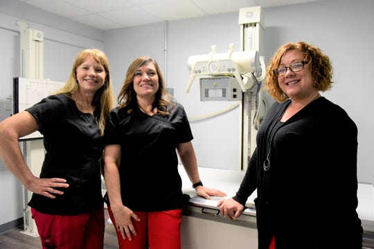 Staff members of Shiloh Medical Services show of the facility's X-Ray machine. Picture are, from left: Chris Coffy, RN; Nicole Simmons, RN; and Deana Hall, administrative assistant.