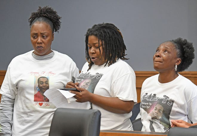 Sondra Bryant, left, mother of murder victim Terrence Harris, DeAngela Fuller, center, Harris' aunt, and Pam Shirley, his grandmother, address the court and Deshawn Dowdell before he was sentenced Wednesday to 26 years to life.