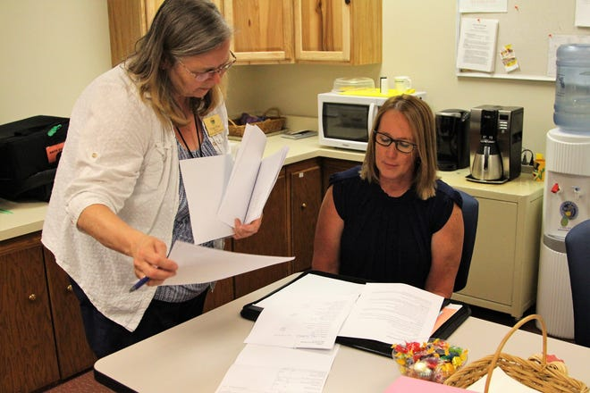 Cindy Price, with the Marion County Board of Elections, shows Cheryl Plaster, superintendent of the Marion County Board of Developmental Disabilities, comparisons between each precinct involved in a Wednesday morning ballot recount. The Board of DD's 1.7 mill levy lost by a margin of 19 votes.