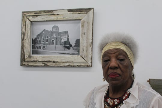 Mary Mitchell, 83, poses in front of a photo of Mt. Pisgah CME Church located on 2490 Park Ave. in Orange Mound.