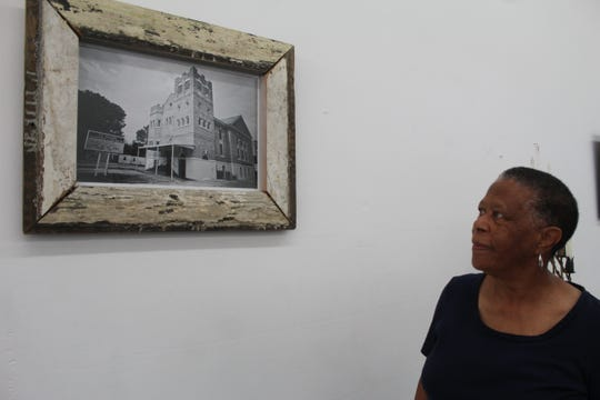 Ellen Perkins, a generational descendant and member of the Orange Mound Preservation and Heritage Society, looks at a picture of the historic Mt. Moriah Baptist Church located on 2634 Carnes Avenue.