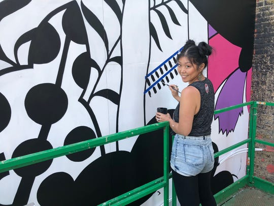 Emma Daisy Gertel was commissioned to paint a mural on the west side of a building on the corner of North Lovell Street and West Wisconsin Avenue.