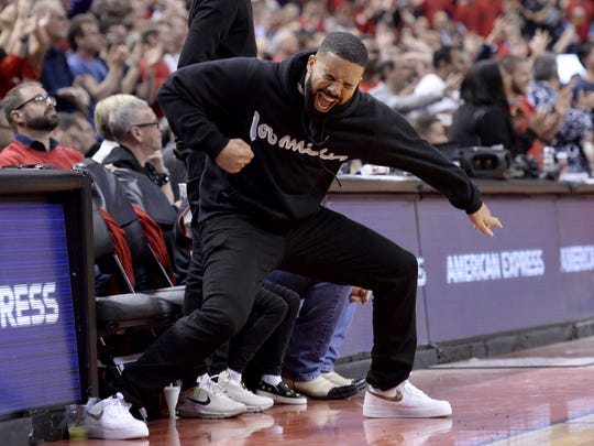 Drake celebrates a Raptors three-point basket during Game 6.