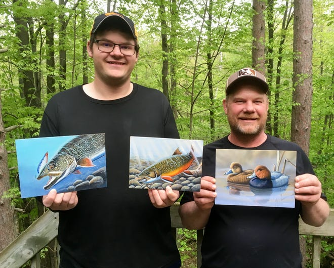 Jon Rickaby, right, and his son Ryan, both of Suamico, show off their winning entries from the 2019 Wisconsin wildlife and fish stamp design contests run by the Department of Natural Resources.
