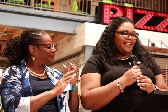 Gwen Moore and Ravae S.M. Sinclair, president of the doula certifying organization DONA, speak Wednesday during a news conference at Sherman Phoenix.