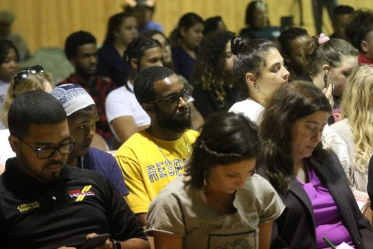 People are shown at a community meeting in the wake of a 19 year-old being beaten and choked by police.  Police say the teen was resisting arrest. Tuesday, May 28, 2019