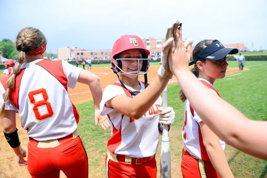 Mount Olive's Alyssa Segnello, center, gets high-fives from teammates after scoring a run. Mt. Olive defeated Bergen Tech, 7-0, in the North 1, Group 4 softball final on Wednesday, May 29, 2019, in Flanders.