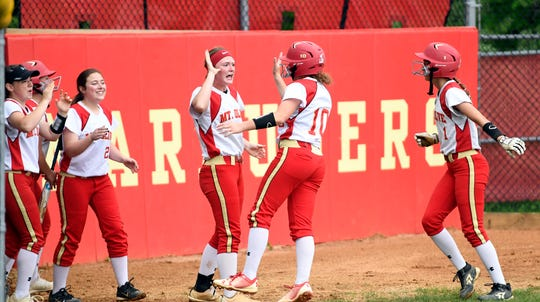 Mount Olive teammates welcome home Gabby Grillo (10) and Lindsey Walter (1) after Kaitlin Pettenger's (not pictured) two-run hit against Bergen Tech. Mt. Olive defeated Bergen Tech, 7-0, in the North 1, Group 4 softball final on Wednesday, May 29, 2019, in Flanders.