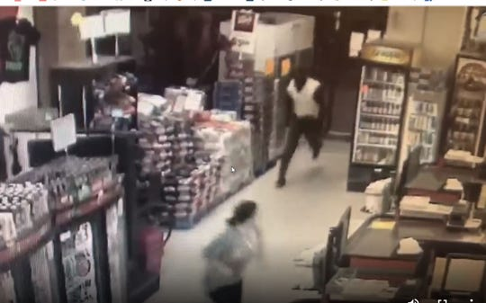 Surveillance footage shows three employees running away from the front of the store as the man is seen stooping to come through the door. The employees were not harmed.