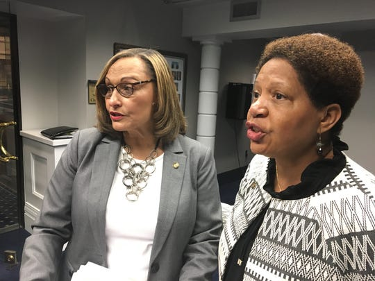 Sen. Vivian Davis Figures and Rep. Adline Clarke, both D-Mobile, discuss a bill that would ban discrimination based on race or sex on May 29, 2019.