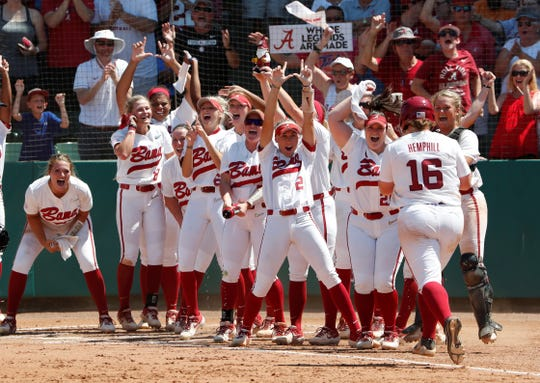 Alabama's Bailey Hemphill (16) gets ready to touch home plate after a home run against Texas on May 25.