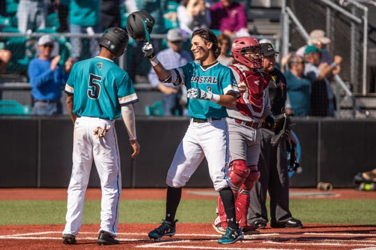 Coastal Carolina's Parker Chavers (3) celebrates with a teammate after scoring against Troy on March 23, 2019.