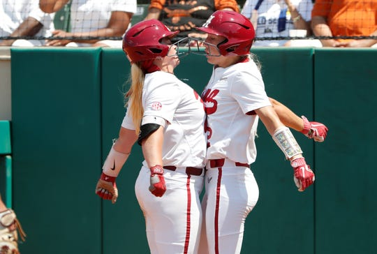 Alabama's Maddie Morgan (0) and Skylar Wallace (2) celebrate scoring a run in an 8-5 win over Texas on May 25 in the NCAA softball Super Regional.