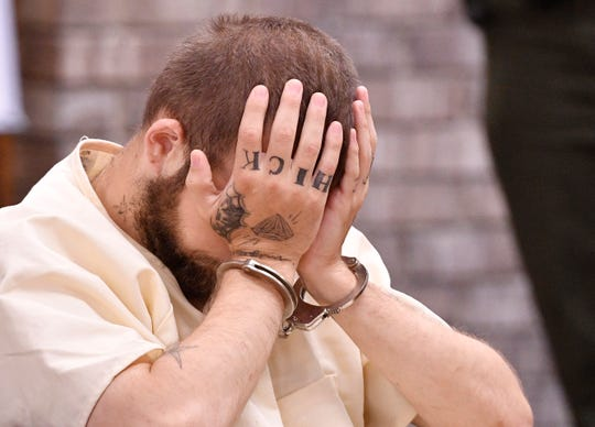 Michael Cummins puts his head in his hands during his second hearing May 29, 2019, in Gallatin. Charges include one count each of criminal homicide, theft of property $10,000 to $60,000 and attempted first-degree murder, and seven counts of first-degree murder.
