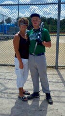 Tyler Brown, right, poses with his mom Cindy at a ball field in Ohio. Cindy died of cancer on Aug. 3, 2012. Brown now pitches for Vanderbilt.