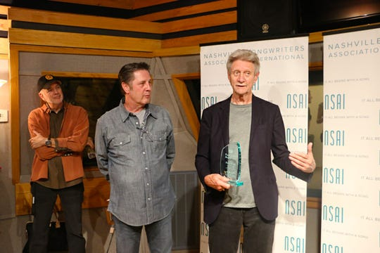 Ralph Murphy accepts The Maggie Cavender Award in recognition of his extraordinary service to the songwriting community in this undated submitted photo.