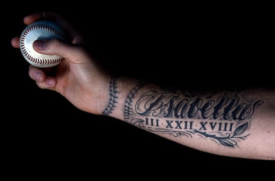 Vanderbilt pitcher Tyler Brown has a tattoo of his daughter's name, Isabella, on his throwing arm.