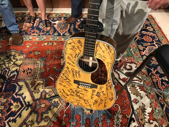 One of the guitars signed by country music legends is displayed in Belmont's Gallery of Iconic Guitars.