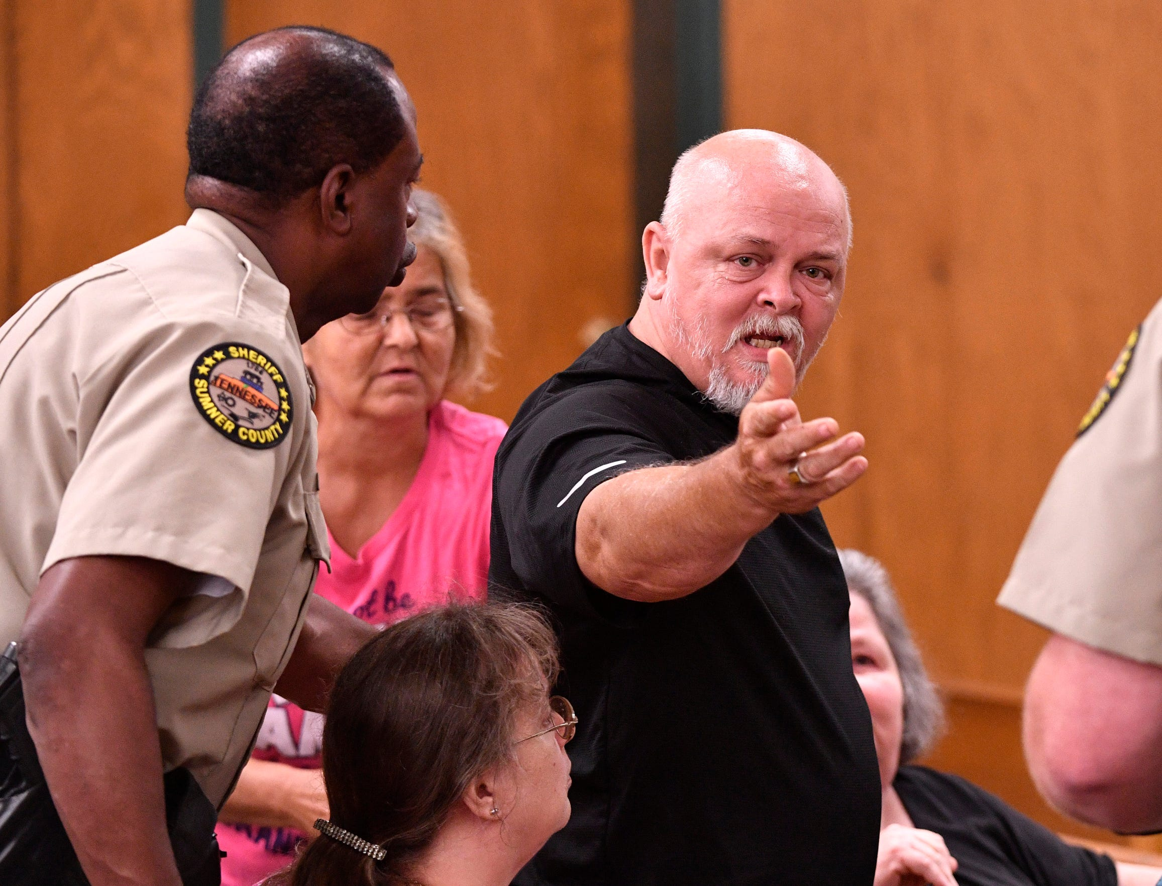 Steve McGlothlin is escorted out of court after an outburst while listening to testimony about the death of his 12-year-old niece during Michael Cummins' hearing Wednesday, May 29, 2019, in Gallatin.