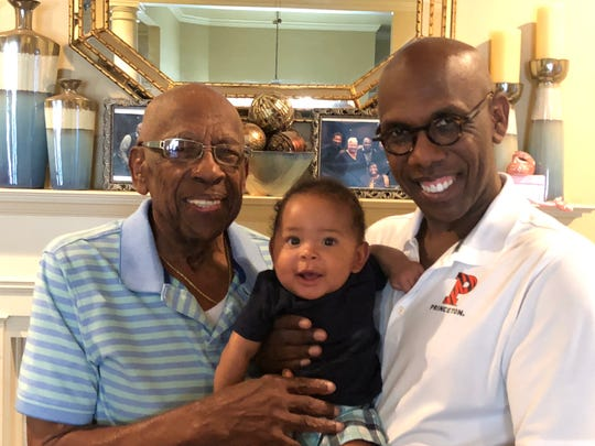 Mount Zion Baptist Church senior pastor Bishop Joseph W. Walker III, right, with his dad, Joseph Jr., and his son, Joseph IV.