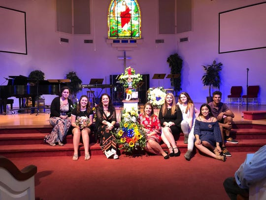 Several of Daniel Shields' siblings pose near the altar during services after his death.