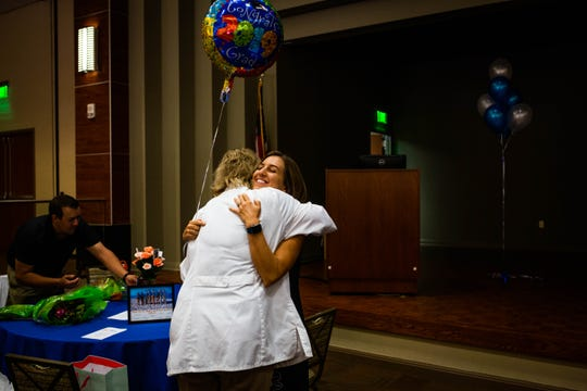 Instructor Nicole Cholka hugs Lisa Fletcher after the Project SEARCH graduation at NCH Baker Hospital Downtown on Wednesday, May 29, 2019.
