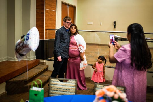 Program graduates Caleb Caldwell, 19, and Nayeli Lora, 20, get their photo made together after their graduation from Project SEARCH at NCH Baker Hospital Downtown on Wednesday, May 29, 2019. Caldwell and Lora met in the program and have been dating since November 2018.