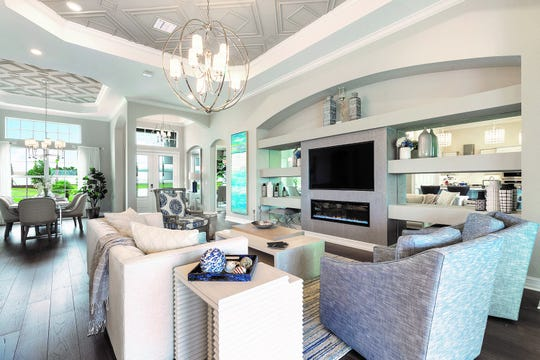 This home showcases a contemporary coastal theme in a relaxed environment featuring beautiful ceiling details in the great room.