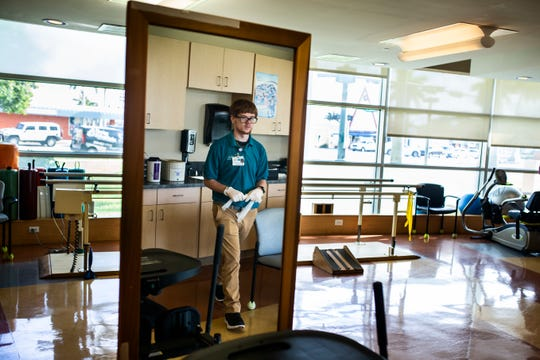 Caleb Caldwell, 19, cleans during his internship through Project SEARCH at NCH Baker Hospital Downtown on Thursday, May 2, 2019. In the future, Caldwell is interested in pursuing sports medicine and has been able to intern in the Outpatient Therapy department with Project SEARCH.