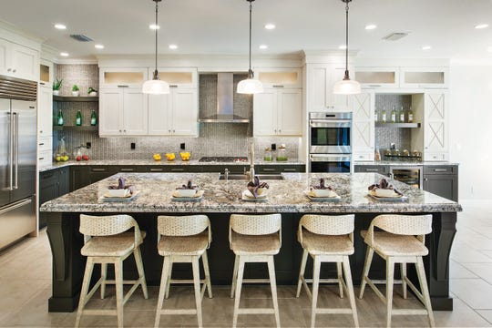 The 2,285 square-foot Serino features three bedrooms, two and one-half baths, a gourmet kitchen, and a two-car garage.