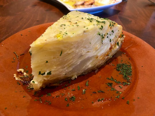 This tortilla Española from Barbosa Kitchen includes potatoes and onions.