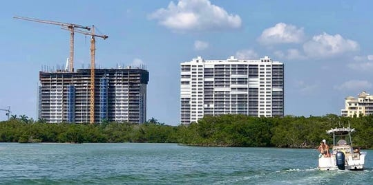 Tower 200 at Kalea Bay (left) will be topped off within a few weeks.