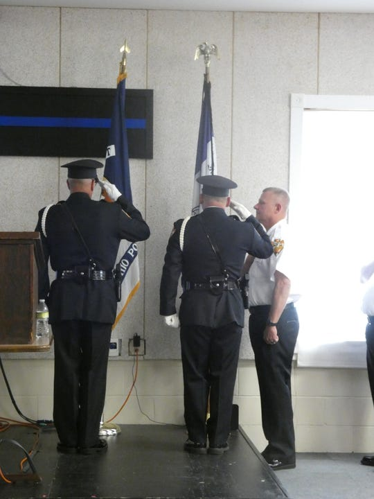 Members of the Newark Police Honor Guard salute and Newark Police Chief Barry Connell places his hand over his heart toward the flags during the presentation of colors at the Newark Division of Police Awards Presentation on Wednesday, May 2019, 2019.