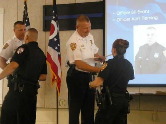 Newark Police Chief Barry Connell presents Officer April Fleming with a Lifesaving Ribbon at an awards ceremony on Wednesday, May 29, 2019. Fleming and Officer Nolen Gossett received the award for their efforts to save an individual suffering a cardiac arrest.