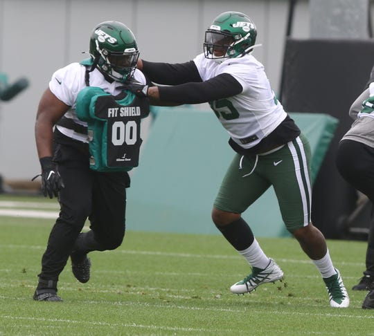 Defensive linemen Frederick Jones blocks first round draft pick Quinnen Williams, as they go through a blocking drill as part of Organized Training Activities conducted at the Atlantic Health NY Jets Training Facility in Florham Park, NJ on May 29, 2019.