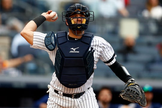 May 29, 2019; Bronx, NY, USA; New York Yankees catcher Austin Romine (28) throws to first base for an out on San Diego Padres third baseman Ty France (11) during the ninth inning at Yankee Stadium. Mandatory Credit: Adam Hunger-USA TODAY Sports