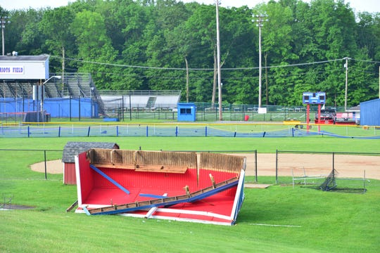 The dugout was blown from the concrete foundation at the high school. Residents near the Lenape Valley Regional High School woke to to survey the storm damage done to their neighborhood on Wednesday May 29, 2019 in Stanhope, N.J.  Uprooted trees, broken branches, trees on homes, debris in pools, downed utility poles, an over turned dugout at the high school and no power is just some of the damage done after a storm went through the Borough of Stanhope