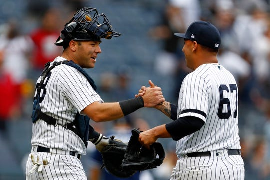 May 29, 2019; Bronx, NY, USA; New York Yankees catcher Austin Romine (28) celebrates with Yankees pitcher Nestor Cortes Jr. (67) after defeating the San Diego Padres at Yankee Stadium. Mandatory Credit: Adam Hunger-USA TODAY Sports