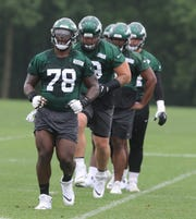 Offensive tackle Jonotthan Harrison warms up with offensive linemen before starting practice as part of Organized Training Activities conducted at the Atlantic Health NY Jets Training Facility in Florham Park, NJ on May 29, 2019.