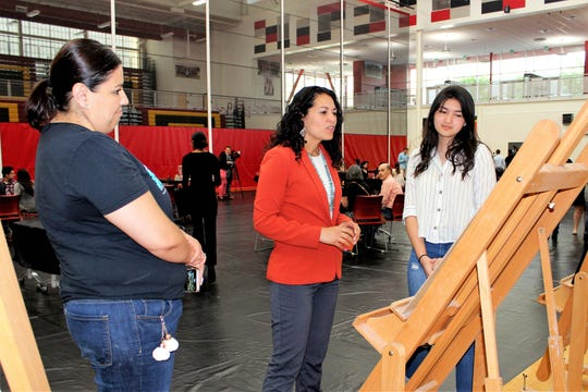 U.S. Rep. Xochitl Torres Small, D-NM, center, views student artwork during the Congressional Art Competition reception on Friday, April 26, 2019 in the gymnasium of Centennial High School.